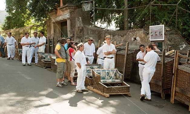 BENF0M Toboggan drivers awaiting their next passengers, the Monte Toboggan run, Monte, Funchal, Madeira